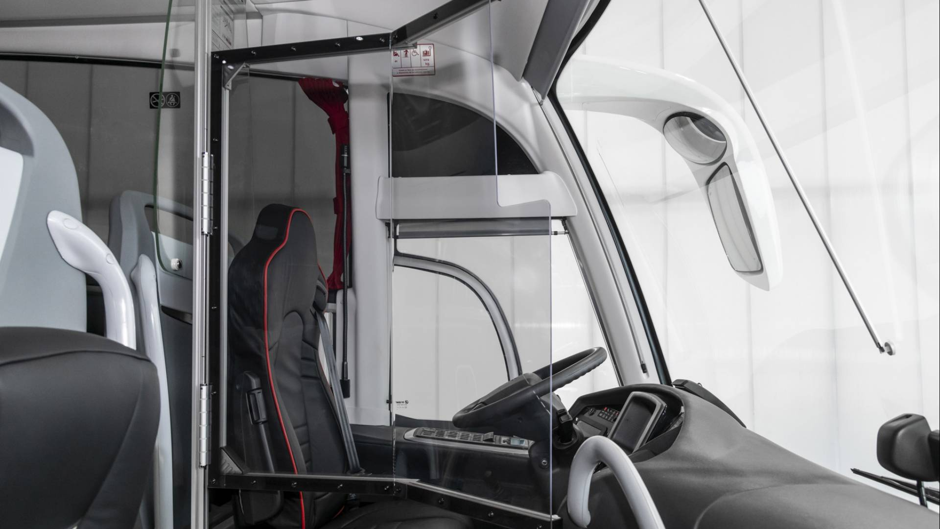 Driver's compartment partition panel, passenger seat protection panels and air purifier for minimising the risk of Covid-19 infection